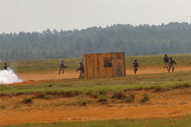 Paratroopers from 3rd Brigade Combat Team, 82nd Airborne Division, continue their airfield seizure mission after taking control of an airfield building on Sicily drop zone on Fort Bragg, NC on May 20, 2011. The exercise took place during the Joint