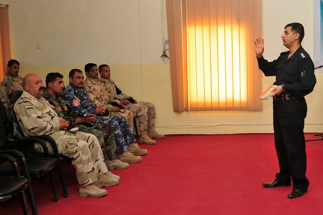 "CONTINGENCY OPERATING SITE WARRIOR, Iraq - Iraqi Police Capt. Fasil Gaze Mohmod, legal officer and law instructor at the Iraqi Police Academy, teaches a class on Iraqi civilian and military law to new members of the Combined Security Forces, ""Golden"