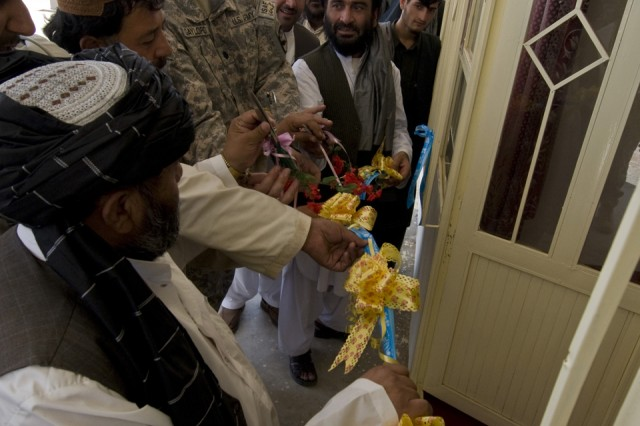 TAKTEH POL, Afghanistan - Lt. Col. James Gaylord, commander, 1st Squadron, 38th Cavalry Regiment, 525th Battlefield Surveillance Brigade, prepares to cut a ceremonial ribbon during the opening of Takteh Pol's new district center in the subdistrict