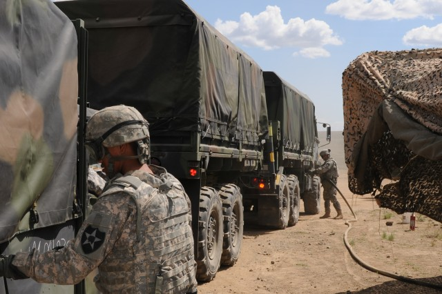 Spc. Thongkham Khamphuny, petroleum supply specialist, A Company, 296th Brigade Support Battalion, fuels a truck at the refill on the move (ROM) point at Yakima Training Center, May 20. The ROM is the first place an incoming convoy stops at to refill