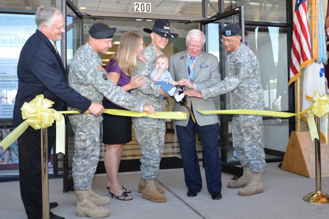 Carl R. Darnall Army Medical Center officially opened its Community Based Medical Home in Harker Heights, Texas, in a ribbon cutting ceremony May 17. Brig. Gen. Joseph Caravalho (right), commander of the Southern Regional Medical Command at Fort Sam