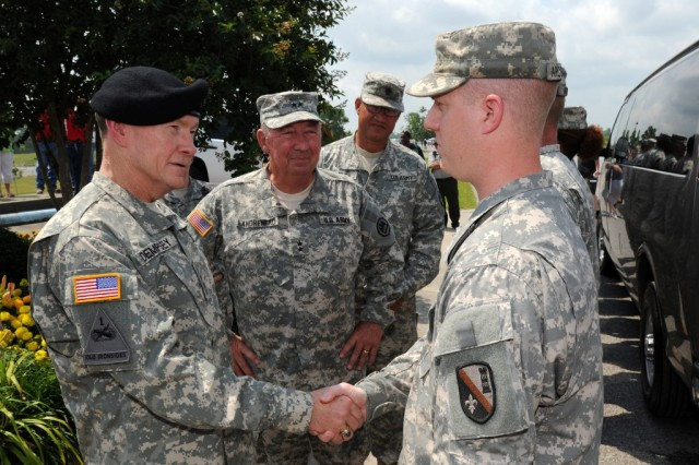 Army Chief of Staff Gen. Martin Dempsey along with Maj. Gen. Bennett C. Landreneau, adjutant general of the Louisiana National Guard, and Command Sgt. Maj. Tommy Caillier, senior enlisted advisor, presents a coin and thanks Pvt. Arceneaux, 225th Engineer