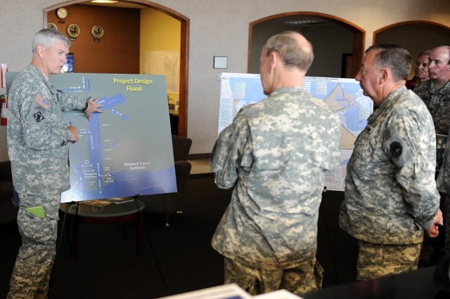 Army Chief of Staff Gen. Martin Dempsey and Maj. Gen. Bennett C. Landreneau, adjutant general of the Louisiana National Guard, are briefed by Maj. Gen. Michael Walsh, commander of the U.S. Army Corps of Engineers Mississippi Valley Division, on the