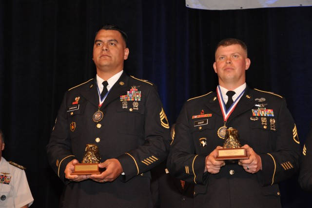 Sgt. 1st Class Gabriel A. Cardenas, NCOIC, Directorate of Training and Doctrine, stands next to Staff Sgt. Benjamin L. Sharp, JTAGS master training and evaluation NCIOC as the 14 outstanding enlisted nominees recieve their awards during the Armed Forces