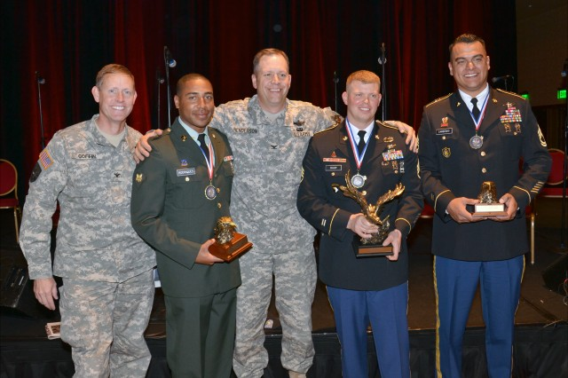 Col. Timothy Coffin, deputy commanding officer for Operations; USASMDC/ARSTRAT; Spc. Roger R. Rodrigues, 1st Space Battalion signals anaylist; Col. Eric Henderson, commander, 1st Space Brigade; Staff Sgt. Benjamin L. Sharp, JTAGS master training and
