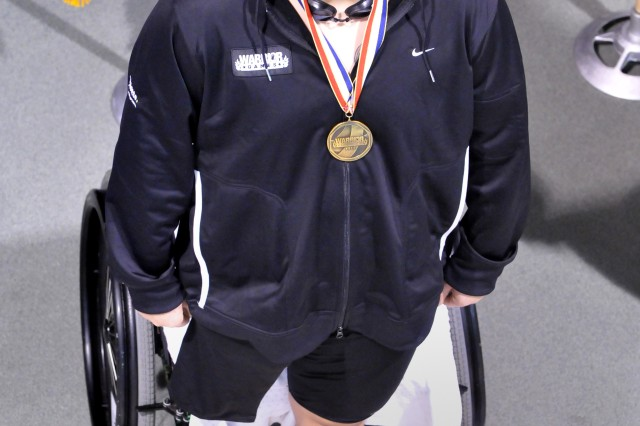 Spc. Andy Kingsley receives a Bronze Medal for swimming May 20, 2011. He placed third in both the 100-meter freestyle and 50-meter backstroke during the Warrior Games at the Olympic Training Center in Colorado Springs, Colo.