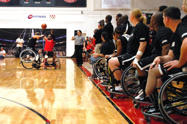 Members of the Army's wheelchair basketball team watch a teammate fight for the ball on the court at Sports Center I, Olympic Training Center in Colorado Springs, Colo., May 20, 2011. Army defeated the Marines 44-19, winning the gold.