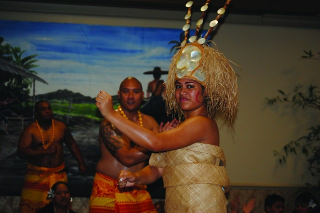 "Sina Sekai performs ""Taualuga,"" a traditional Samoan dance during Fort Polk's Asian Pacific Heritage Month celebration. The taualuga is perfomed by the son or daughter of a chief and is a solo performance."