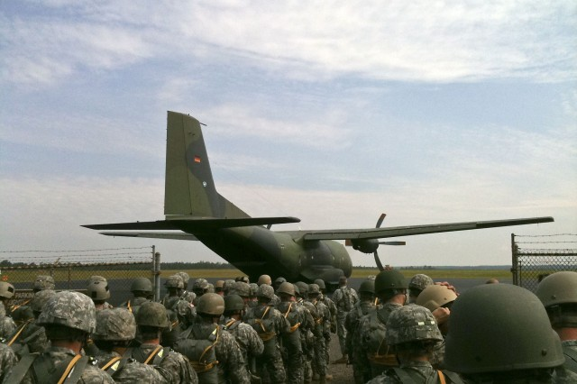 A German C-160 high-performance aircraft stands ready to be boarded by U.S. Army Special Operations Command and U.S. Army Civil Affairs and Psychological Operations Command paratroopers participating in an airborne operation with the German Army's