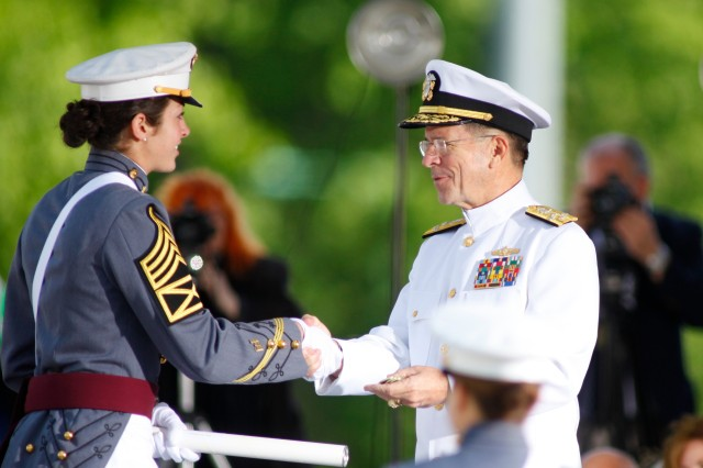 Admiral Michael G. Mullen, Chairman of the Joint Chiefs of Staff, hands the diploma to 2nd Lt. Erin Anthony during the Class of 2011 Graduation Ceremony in Michie Stadium on May 21. Photo by Tommy Gilligan/West Point Public Affairs