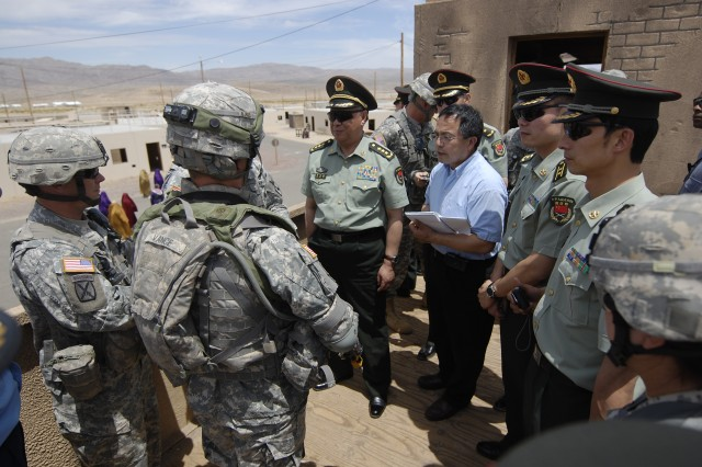 FORT IRWIN, Calif.-General Chen Bingde, Chief of the General Staff of the People's Liberation Army of China, is shown the standard equipment of a U.S. Soldier at the National Training Center on Fort Irwin, Calif., May 21. Chen and a Chinese PLA