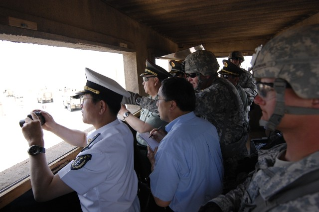 FORT IRWIN, Calif.-General Chen Bingde, Chief of the General Staff of the People's Liberation Army of China, watches an in iteration of an Urban Mounted Patrol Lane at the Shar-e Tiefort training village at the National Training Center on Fort