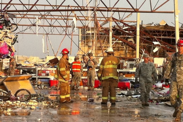 Missouri National Guard Soldiers with the 294th Engineer Company work search-and-rescue missions in Joplin, Mo., hours after a deadly tornado passed through the city May 22, 2011.