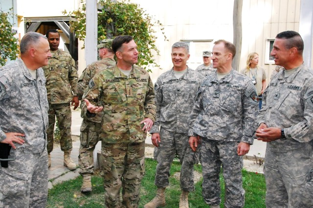 Lieutenant General William B. Caldwell IV, commanding general, NTM-A/CSTC-A, draws smiles from Brig. Gen. Tom Cosentino (left), DCOM-Regional Support; Col. Ron Metternich, RSC-East commander; Col. Greg Baine, RSC-South commander; and Col. Paul Calbos,
