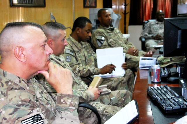 Sergeant Major Michael Mosites (left) of RSC-Capital, along with other RSC sergeants major, listens in during a meeting of same-ranked military personnel May 17 at the conference.