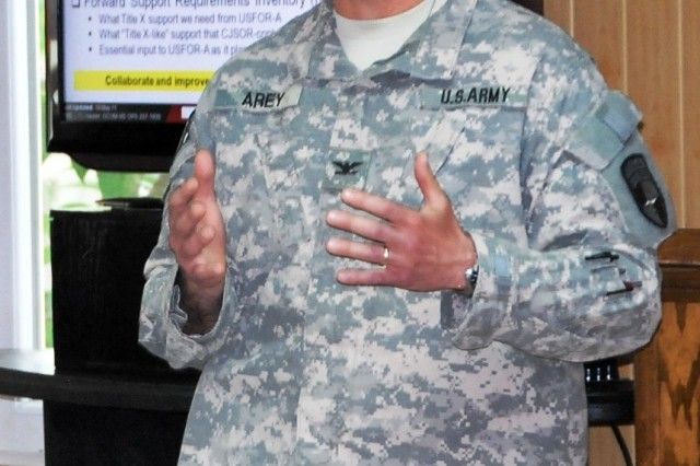 Colonel Howard Arey, DCOM-Regional Support chief of staff, conducts the out brief May 19.