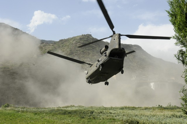 KHOWST PROVINCE, Afghanistan- A CH-47 chinook lands to pick up Soldiers from the 3rd Brigade Combat Team, 1st Infantry Division, Task Force Duke, and officials from the Government of the Islamic Republic of Afghanistan after a meeting with villagers in
