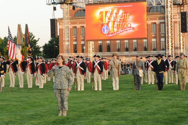 "Soldiers from The 3rd U.S. Infantry Regiment (The Old Guard) and The U.S. Army Band ""Pershing\'s Own"" participate in the 2011 Twilight Tattoo on Fort McNair, D.C.  Twilight Tattoo is a free, interactive, high-energy performance meant to"