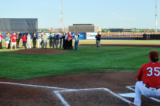 Prior to game-time, Maj. Gen. Yves J. Fontaine, Commanding General Army Sustainment Command, threw out the first pitch.