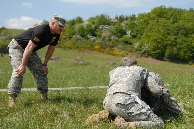 Soldiers collide during a combatives tournament at the 18th Military Police Brigade's Warrior and Warrior Leader of the Year competition May 1-3 in Baumholder, Germany. Modern Army combatives was one of twelve events the Soldiers were tested on
