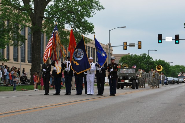 Joint Color Guard leads the parade down Rodman Avenue during Rock Island Arsenal Armed Forces Day.