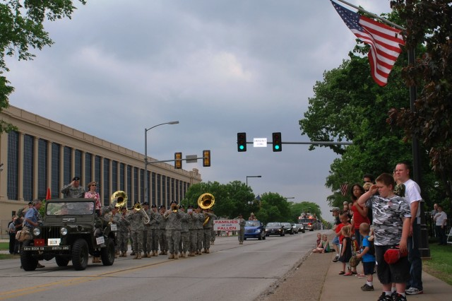 Maj. Gen. Yves Fontaine and his wife, Kathy, stand in their jeep to honor the flag during the National Anthem at the RIA Open House parade.