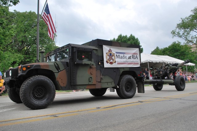 A M119 Howitzer built by the Joint Manufacturing and Technology Center is towed during the Rock Island Arsenal Armed Forces Day Open House parade.