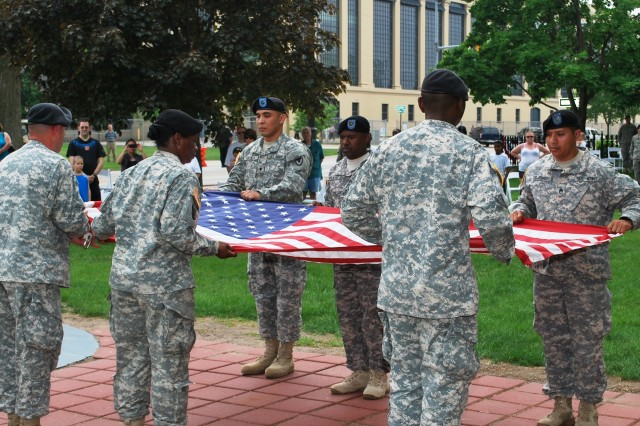 A detail of Army Sustainment Command Soldiers fold the colors during retreat ceremony at Rock Island Arsenal Armed Forces Day Open House.