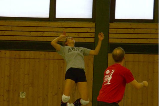 Following a set from her teammate, Capt. Danielle Cork prepares to attack during a recent practice in Grafenwoehr.