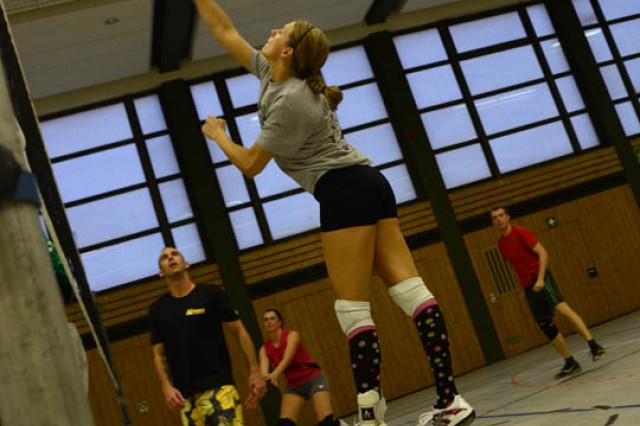 Capt. Danielle Cork spikes the ball during volleyball practice with the Grafenwoehr volleyball team. Cork will represent Army Europe in the 2011 Military World Games in July, playing on the All-Armed Forces volleyball team.