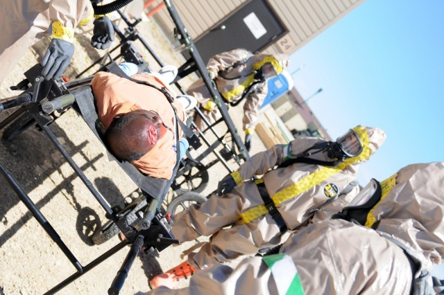 Members of the 434th Chemical Company, Minnesota National Guard CBRNE (Chemical, Biological, Radiological, Nuclear and High Explosives) Emergency Response Force Package (CERFP), assist a role-player posing as a victim during a Vigilant Guard event at