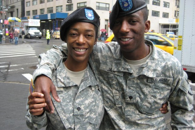 Spc. Cola Jade left and her son Spc. Miami Jade pose near Central Park in Manhattan before marching in a Memorial Day parade on May 15.