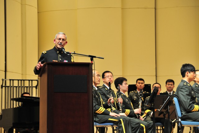 """Col. Thomas Rotondi Jr. leader and commander of The U.S. Army Band """"Pershing's Own"""" gave opening remarks at Tuesday's concert which featured the Military Band of the Chinese People's Liberation Army."""