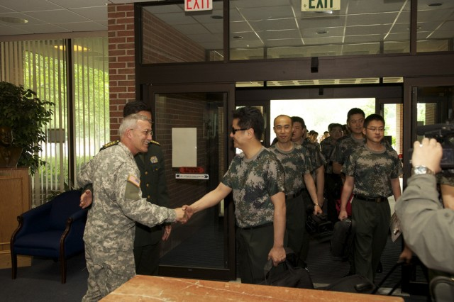 Col. Thomas Rotondi Jr. welcomes Sr. Col. Yu Hai and the members of the Military Band of the People's Liberation Army of China to Brucker Hall.
