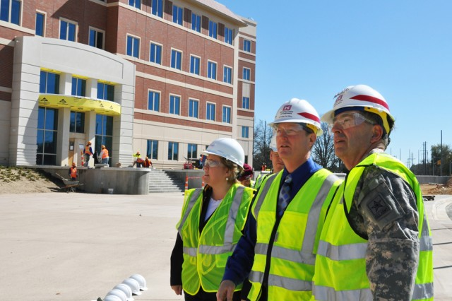 General Peter W. Chiarelli vice chief of staff of the Army Ronna Garrett U.S. Army Forces Command (Forward) officer-in-charge and Ted Kientz FORSCOM liaison team chief view the FORSCOMU.S. Army Reserve Command Combined Headquarters construction project Ma
