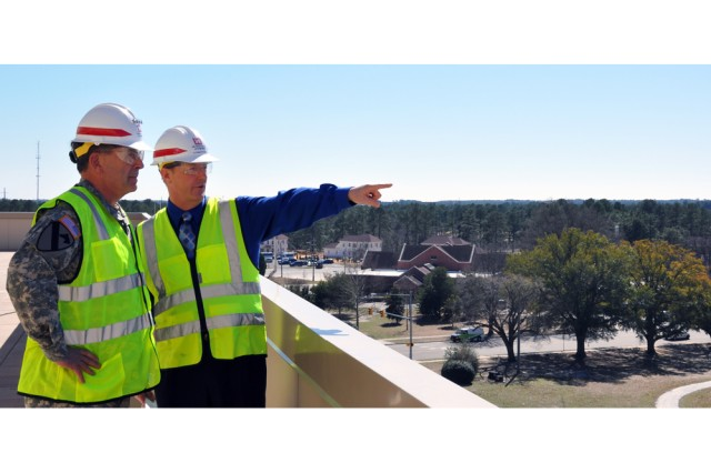 Ted Kientz U.S. Army Forces Command liaison team chief points out landmarks for Gen. Peter W. Chiarelli vice chief of staff of the Army from the 5th-floor terrace of the FORSCOMU.S. Army Reserve Command Combined Headquarters construction project March 3 a