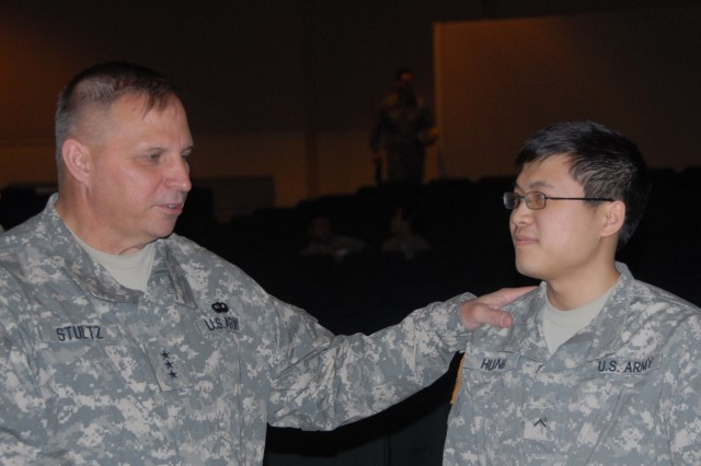 ANCHORAGE Alaska - Lt. Gen. Jack C. Stultz chief Army Reserve talks with Pvt. Zu Huang a fuel attendant for the 1984th U.S. Army Hospital at a town hall meeting held at Joint Base Elmendorf Richardson here April 30. Stultz and his wife Laura visited the t