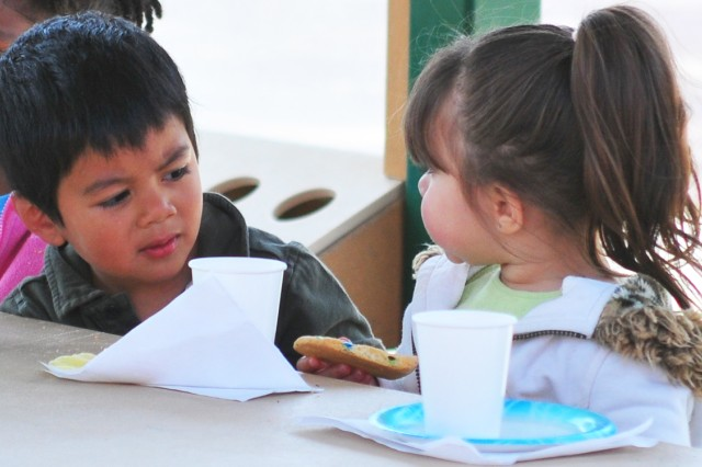 PRESIDIO OF MONTEREY Calif. Aca!A? Children enjoy their Mother's Day party snacks. Monterey Road Child Development Center preschoolers invited their moms to an early Mother's Day celebration at the center May 6.