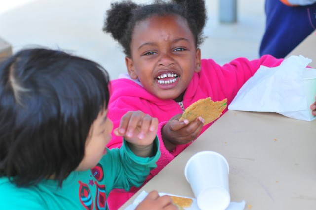 PRESIDIO OF MONTEREY Calif. Aca!A? Monterey Road Child Development Center preschoolers invited their moms to an early Mother's Day celebration at the center May 6.