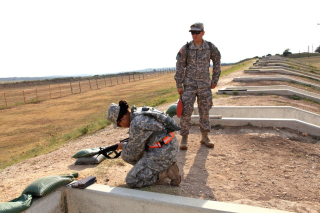 Spc. Marie Peto IMCOM-Pacific Soldier of the Year from USAG Hawaii loads her M4 to shoot for the weapons qualification.