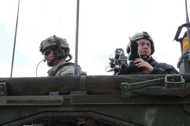 Jeff Van Sant a reporter with Q13 FOX News out of Seattle accompanies Austin Texas native Capt. Andrew Figer commander Bronco Troop 1st Squadron 14th Cavalry Regiment during 3rd Stryker Brigade 2nd Infantry Divisions field training exercise May 22 on Yaki