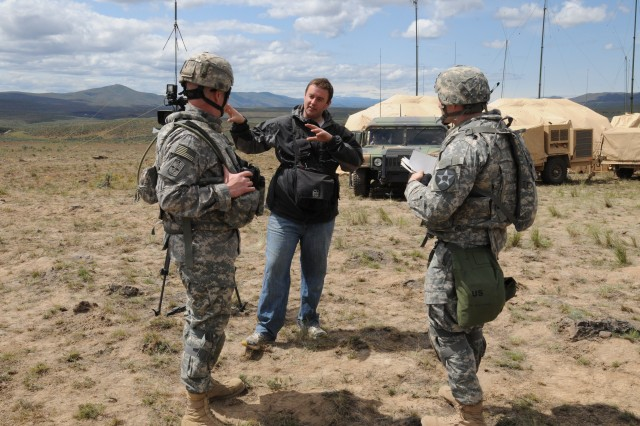 Jeff Van Sant a reporter with Q13 Fox News out of Seattle gathers information about a recent training event with Soldiers of 3rd Stryker Brigade Arrowhead 2nd Infantry Division. Van Sant along with other local media traveled to Yakima Training Center Wash