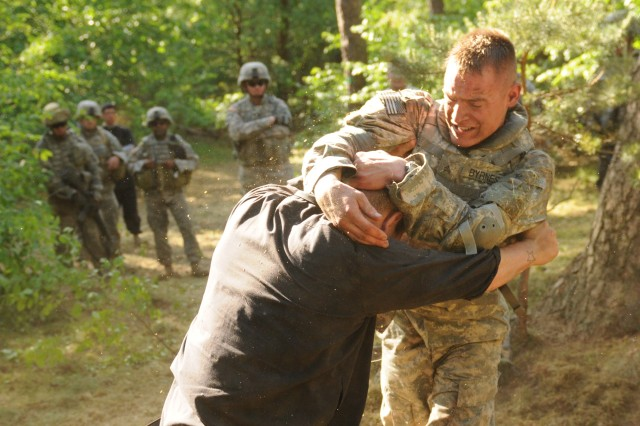 Sgt. James Byrnes a military policeman with the 18th Military Police Brigade fights his way through a multiple combat scenario course culminating with a combatives tournament during the Best Warrior Competition at Lampertheim Training Area in Lampertheim