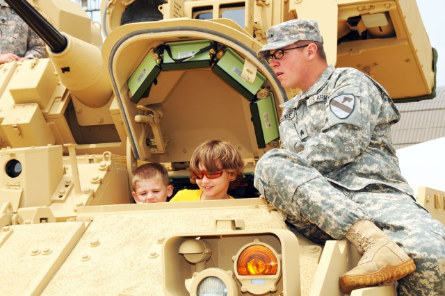 Sgt. Scott Jense 2-5 Cav. 1st BCT 1st Cav. Div. talked with visitors about and kept things safe aboard the Bradley A3 combat vehicle that was on display May 20 during the 2011 Joint Service Open House at Joint Base Andrews Md.