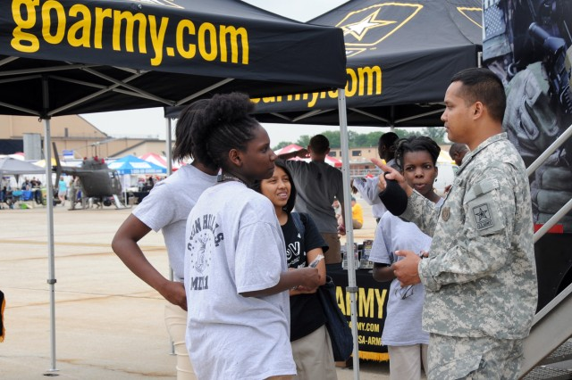 Sgt. 1st Class Rithy Ros 1st Recruiting Battalion Baltimore Md. talks with students and potential recruit May 20 during the 2011 Joint Service Open House at Joint Base Andrews Md.
