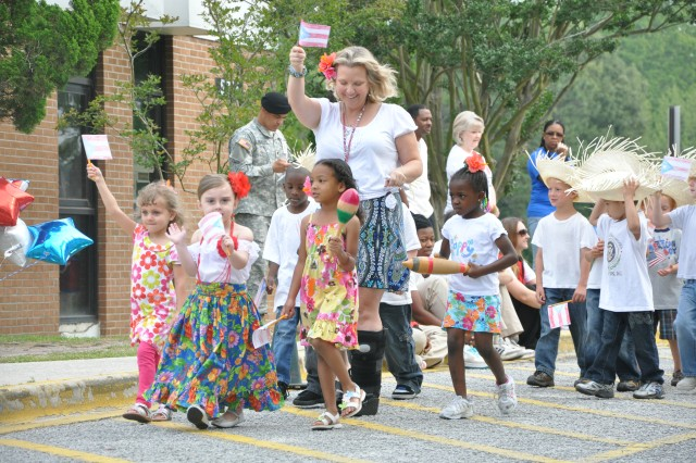 Patricia Brouwer, Pre-K teacher, leads her class — which is representing Puerto Rico — in the International Day parade at Pierce Terrace Elementary School Friday. Twelve countries were represented.