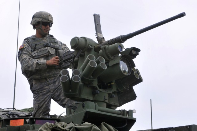 Sgt. Raphael Rosario, squad leader, Charlie Company, 2nd Battalion, 3rd Infantry Regiment, gets the .50 caliber remote weapon system ready for action at a live fire range at Yakima Training Center, Washington May 21.  2-3 is training and qualifying in all