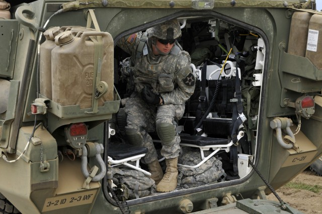 2nd Lt. Warren G. Grambling, platoon leader, Charlie Company, 2nd Battalion, 3rd Infantry Regiment, closes the hatch of his Stryker as they head out to the range at Yakima Training Center, Washington May 21.  2-3 is training and qualifying in all weapons