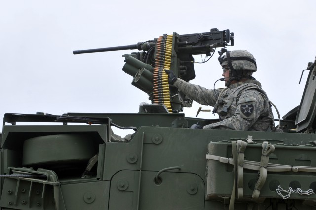 Soldiers from 2nd Battalion, 3rd Infantry Regiment, qualify with the .50 caliber remote weapon system at Yakima Training Center, Washington May 21.  2-3 is training and qualifying in all weapons systems in preparation for 3rd Brigade, 2nd Infantry Divisio
