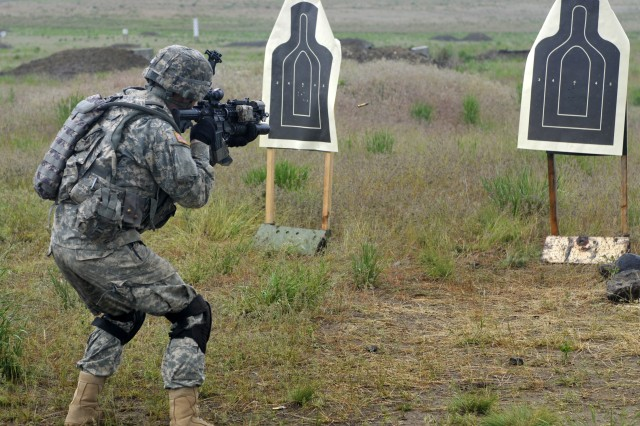 Pvt. 1st Class Robert Frain Jr., rifleman, Bravo Company, 2nd Battalion, 3rd Infantry Regiment, practices short-range marksmanship with his M4 carbine at Yakima Training Center, Washington May 21.  2-3 is training and qualifying in all weapons systems in